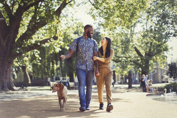 Couple Walking a Dog Outside